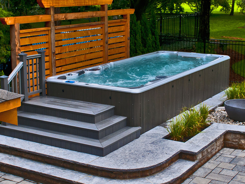 Swim spas wellness spas and covers at the place for Spa swimming pool